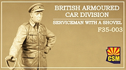 British Armoured Car Division Serviceman with a shovel